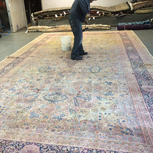 Cleaning Rug in the Saratoga Warehouse